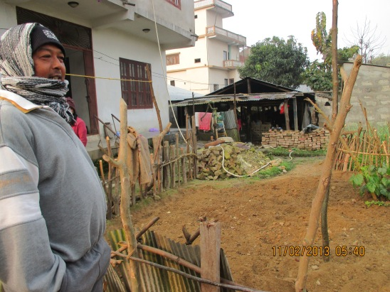 This man is fixing the fence, a rhino came into his garden during the night