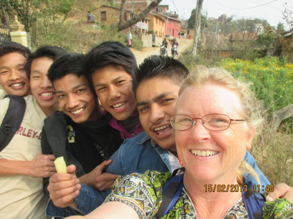 Walking down a dirt road on the outskirts of the capital city, Kathmandu, Nepal. I met these boys coming the opposite way. We spoke English for a few minutes and I answered their questions about