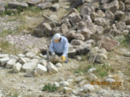 This must be the hardest working man in town. He was digging up stones from an ancient stone wall, and chiseling them into a new shape to sell (from rounded to rectangular)