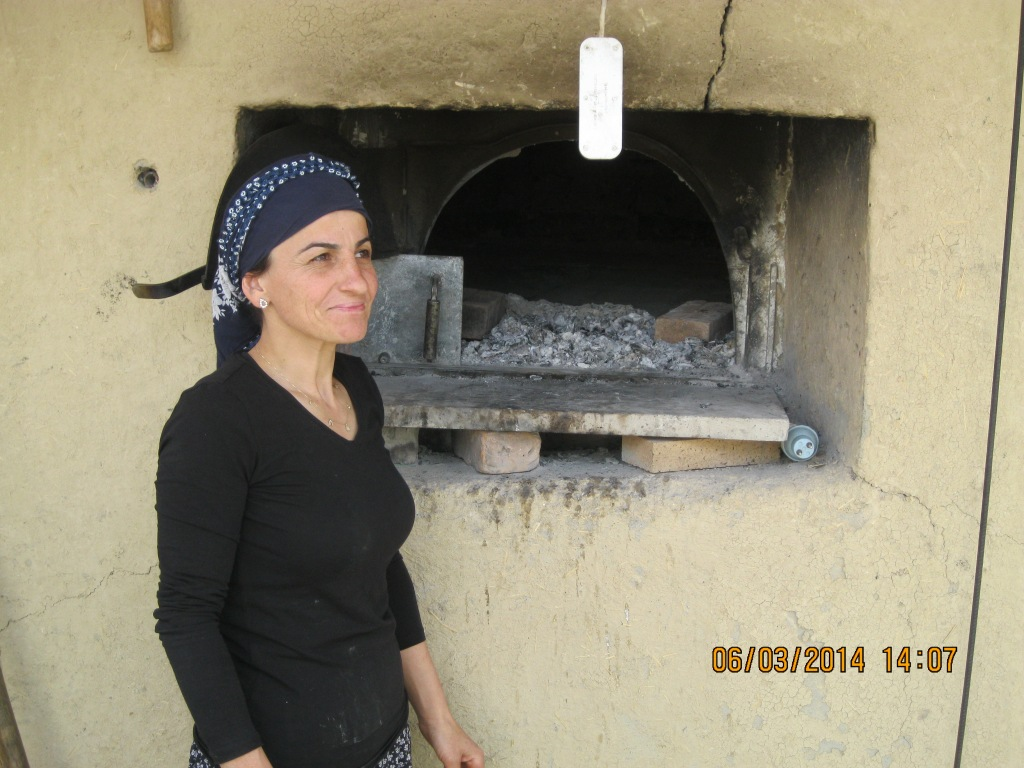 The wife cooked our lunch in an outdoor stone oven.