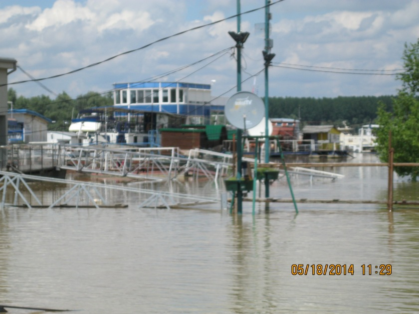 Flooded Danube River, homes and floating restaurants along the banks
