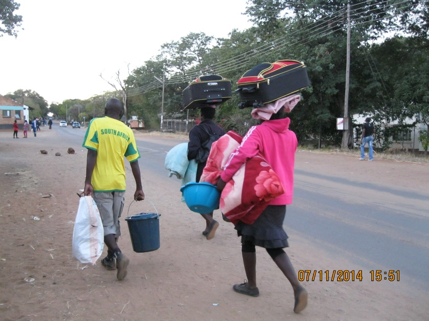 Local women carrying things on their heads
