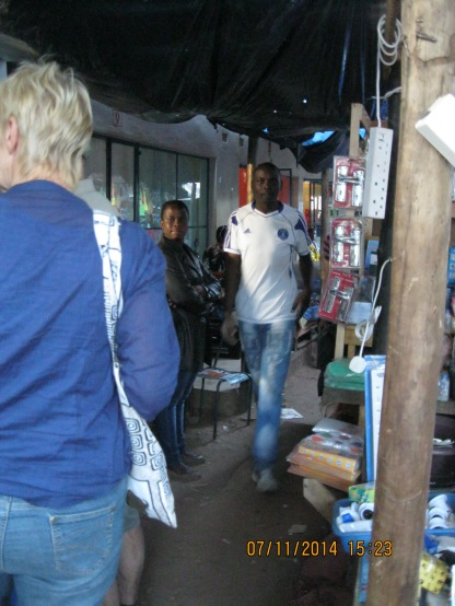 At a local market. People stared at us because white people did not come to this area. People would purchase food for the next day. They did not have enough money to purchase food for more than a day in advance.