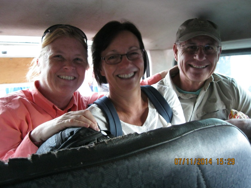 11 people in a minivan type taxi