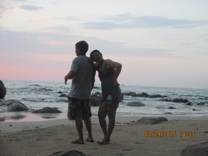 Miw's mom and dad. On a beach that was hit by the tsunami.